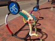 Bike racks decorated with knitted covers